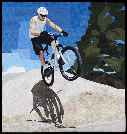 """Quilt art """"Bike Over Boulder"""" by Joan Sowada"""